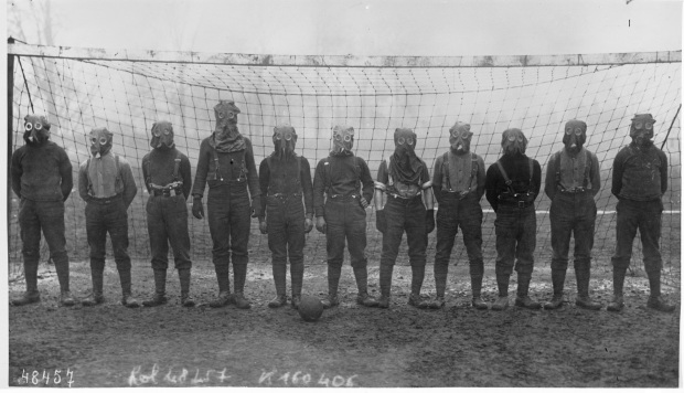 This is a picture of British soccer team wearing their gas masks, circa 1915.