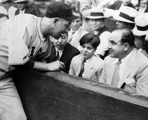 Chicago Cubs catcher Gabby Hartnett signs autograph for Al Capone, who was taking his son to a game.