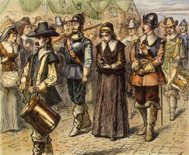 Anne Hutchinson literally being drummed out of Mass. Bay. Probably not accurate considering she had a million kids and a husband not pictured